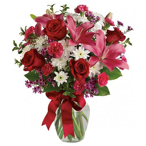 Pristine Arrangement of Pink Lilies N Red Roses in a Glass Vase  <br>