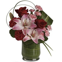 V-Day Special Arrangement of Mixed Flowers in a Leaf-Lined Glass Vase