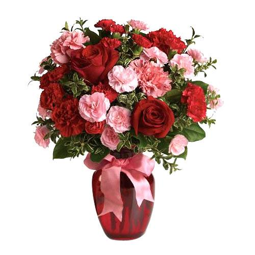 Impressive Bouquet of Carnations and Roses in a Glass Vase for V-day