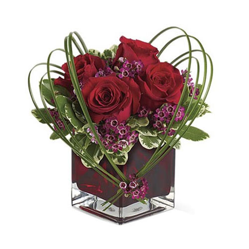 Classically Styled Red Roses Arrangement in a Ruby-Red Cube Vase <br>
