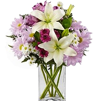 Graceful Arrangement of Mixed Flowers in a Transparent Vase <br>