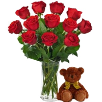 Touching Bunch of Red Roses in a Glass Vase with Adorable Teddy