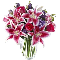 Aromatic Assorted Flowers kept in a Glass Vase<br>