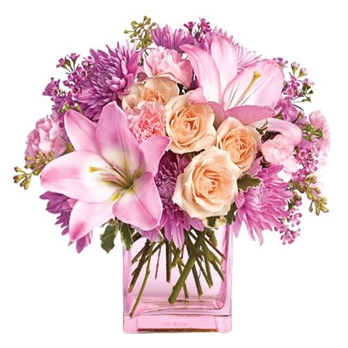 Striking Pink Color Assorted Flowers presented in a Vase<br>