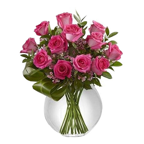 Blooming Pink Color Roses kept in a Glass Vase