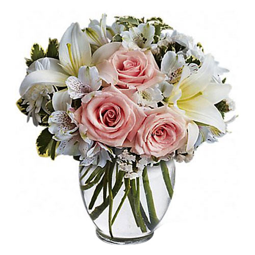 Exotic display of Soft Color Florals in a Glass Vase