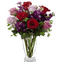 Magnificent Multicolored Florals placed in a Glass Vase <br>