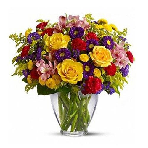Mesmerizing Assorted Flowers kept in a Glass Vase