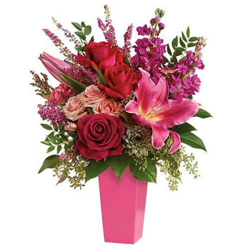 Spectacular Mixed Florals kept in a Pink Vase