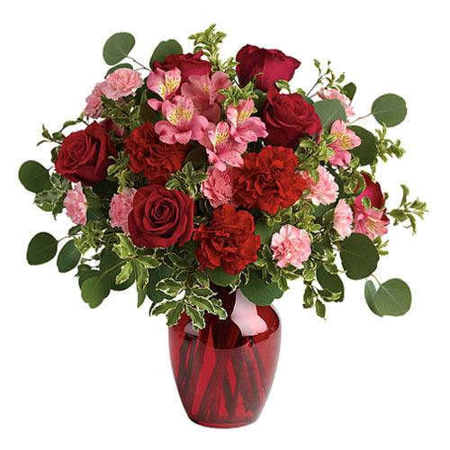 Pristine Red Roses N White Alstroemeria adorned in a Ruby Red Vase
