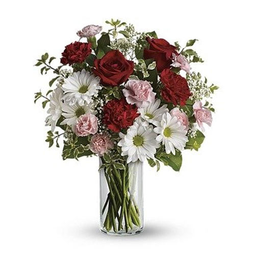 Pristine selection of Colorful Flowers in a Cylindrical Shape Glass Vase