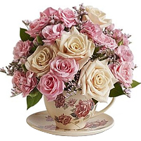 Mesmerizing Pink Color Roses put in a Floral Tea Cup Set <br>