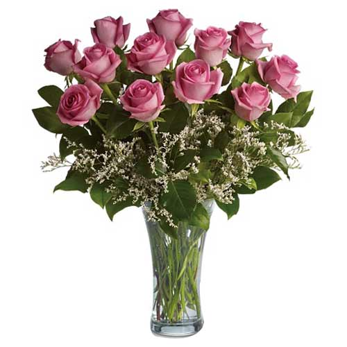 Brilliant Pink Roses put in a Glass Vase<br>