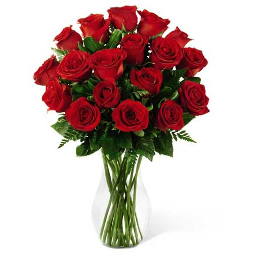 Exquisite Red Color Roses adorned in a Glass Vase<br>