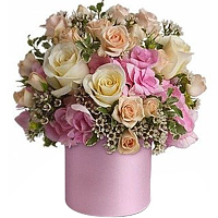 Marvelous Selection of Soft Flowers kept in a Pink Color Satin Vase