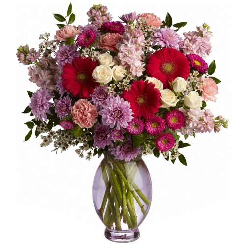 Spectacular Assorted Florals kept in a Glass Vase<br>