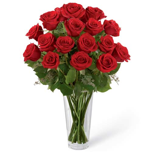 Gorgeous Red Roses decked in a Glass Vase <br>