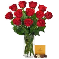 Fantastic Red Roses placed in a Glass Vase with Godiva Chocolate Set