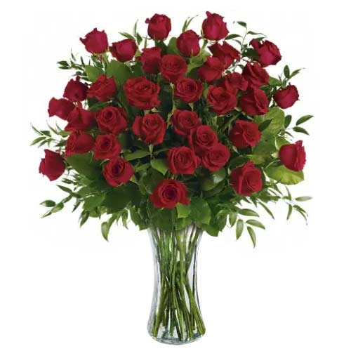 Spectacular Red Roses placed in a Glass vase