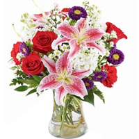 Striking Assorted Florals decked in a Glass Vase